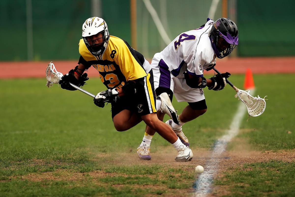 Canva - Man Wearing Yellow and Black Sport Jersey Holding Lacrosse Stick