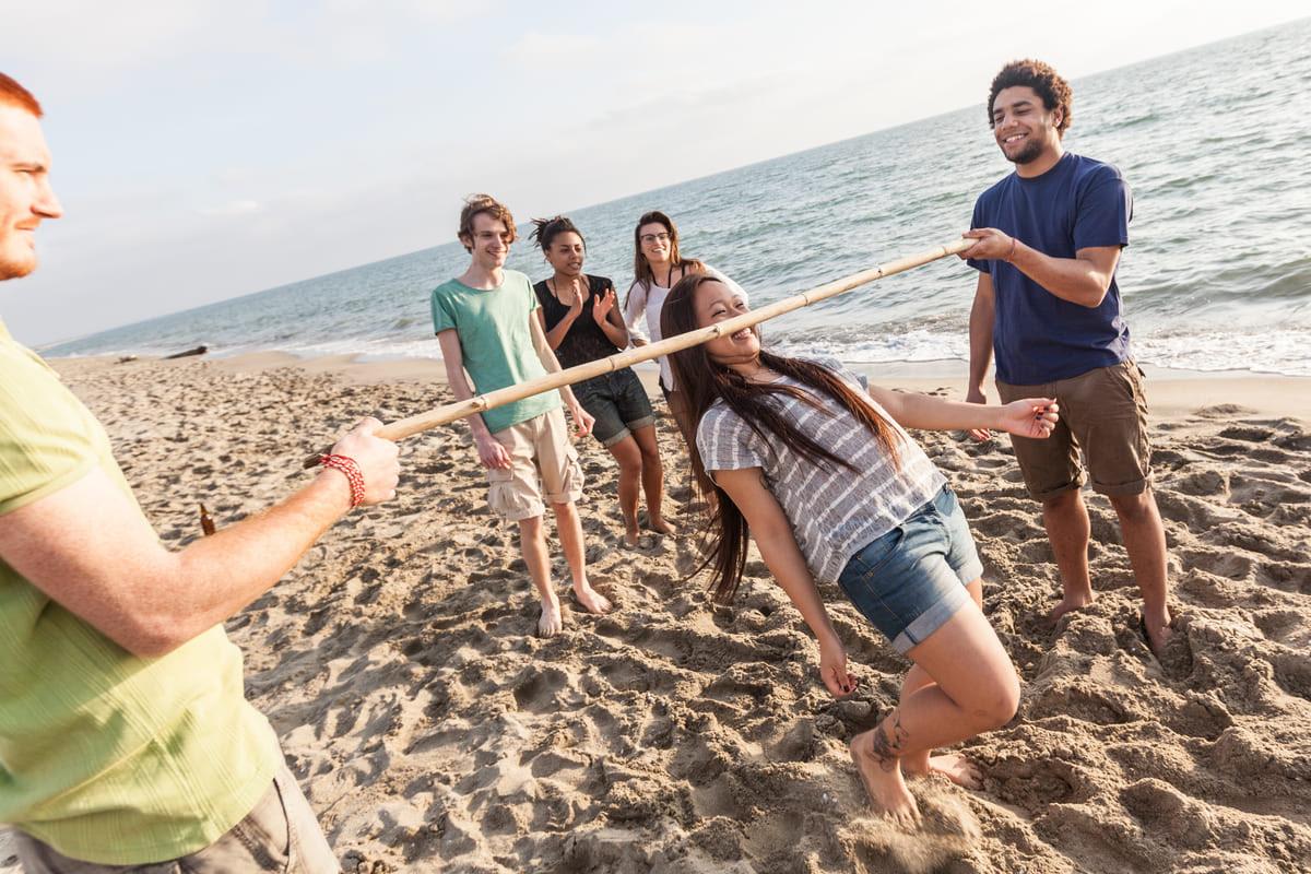 Canva - Friends Dancing Limbo at Beach